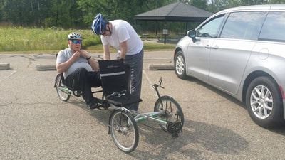 Attorney Dan Kosmowski with his father with dementia and PTSD preparing for a bike ride together