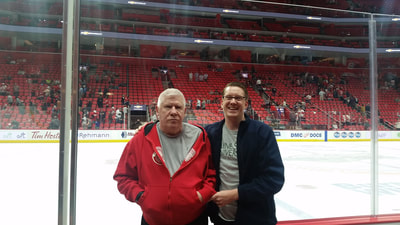 Attorney Dan Kosmowski with his father with dementia and PTSD at Little Caesars Arena